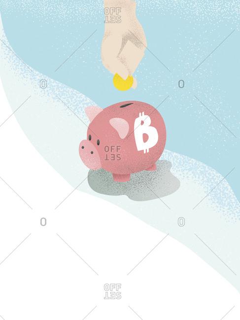 Human hand putting money in a bitcoin piggy bank