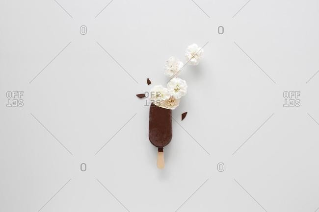 Conceptual chocolate covered vanilla ice cream