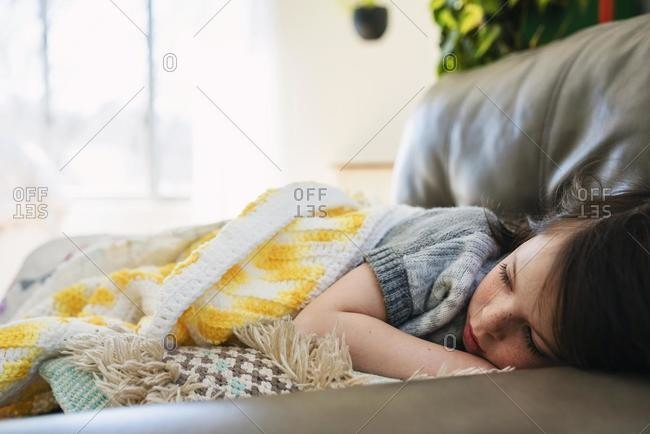 Portrait of a Girl sleeping on a sofa