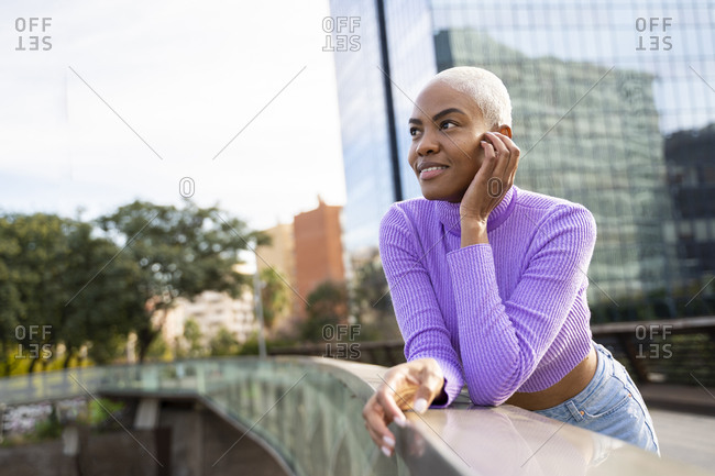 Portrait of mature white haired woman on a bridge in the city