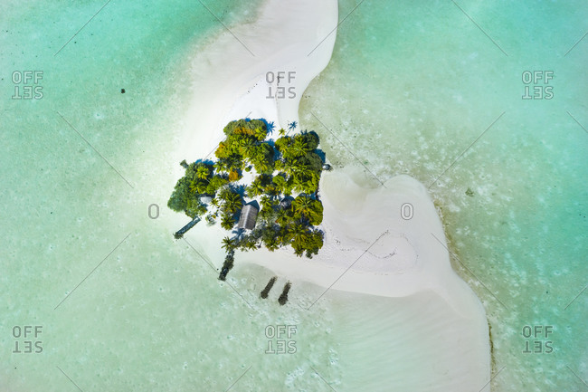 Maldives- Aerial view of secluded hut on small sandy island in South Male Atoll