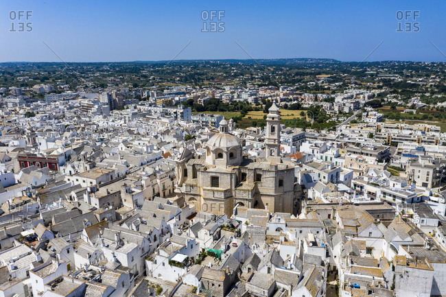 Italy- Locorotondo- Aerial view of Mother Church of Saint George Martyr and surrounding town buildings