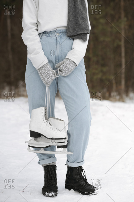 Crop view of woman with ice skates in winter