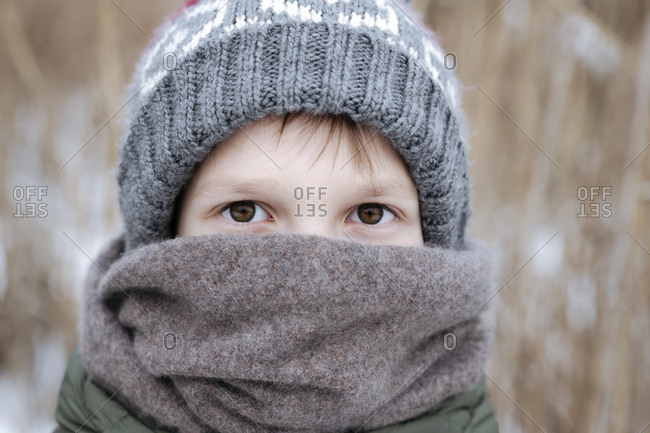 Portrait of boy wearing wool cap and scarf in winter