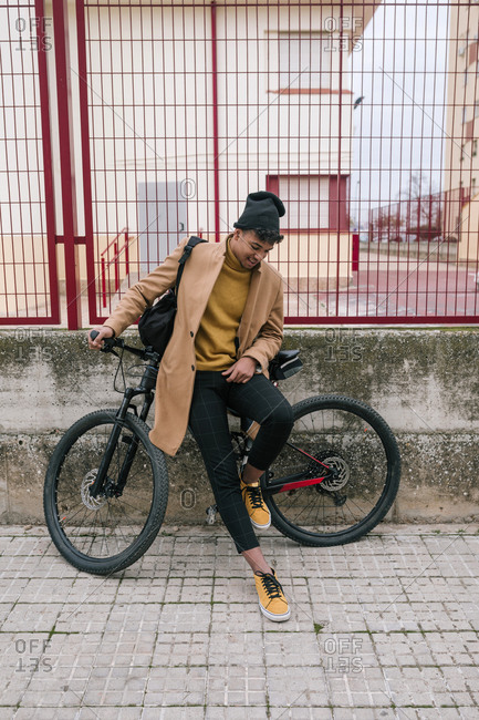 Young man with bicycle in the city