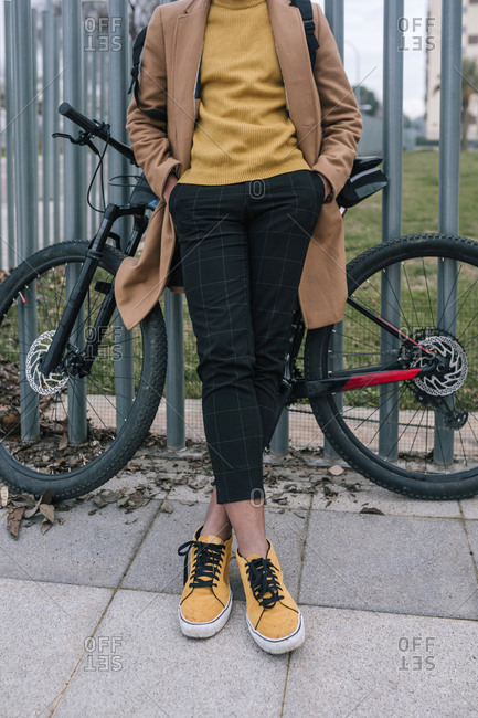Low section of stylish young man with bicycle in the city