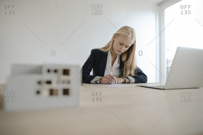 Young businesswoman working at desk in office