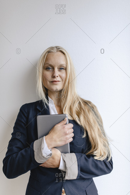 Portrait of a blond young businesswoman holding tablet