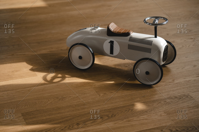 Toy car on wooden floor