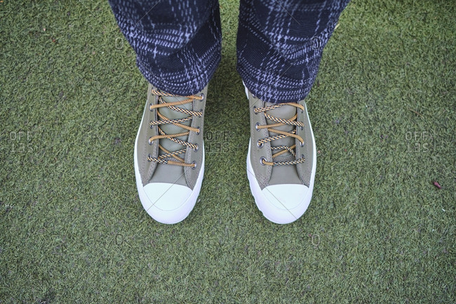 UK- England- London- Shoes of person standing on green grass