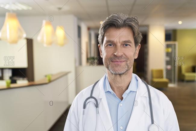 Portrait of confident doctor in his medical practice