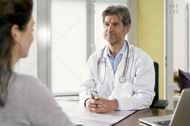 Doctor with female patient in his medical practice
