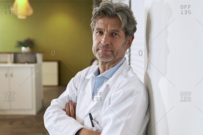 Portrait of confident doctor in his medical practice