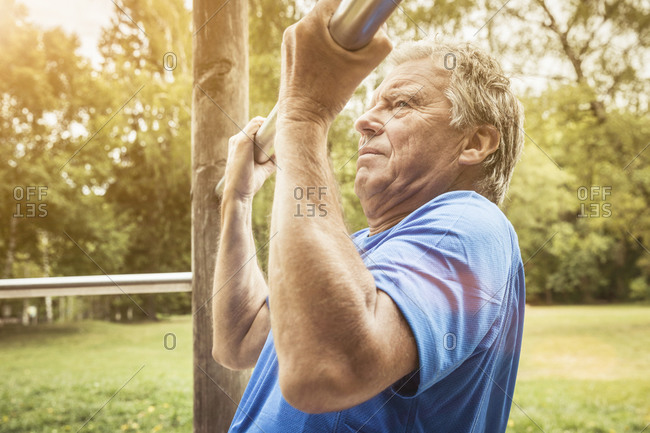 Senior man during workout on high bar