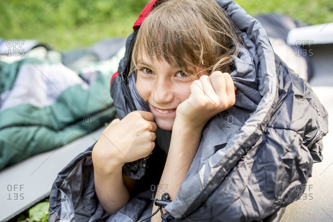 Smiling girl- wrapped in sleeping bag- portrait