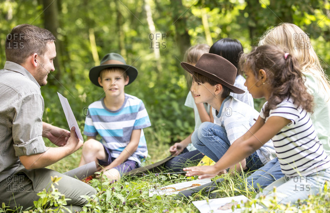 School children learning to to distinguish animal species