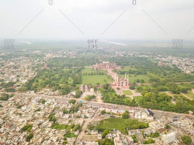 Aerial view of Tomb of Akbar The Great Area surrounded by houses and trees, Sikandra, Agra, Uttar Pradesh, India