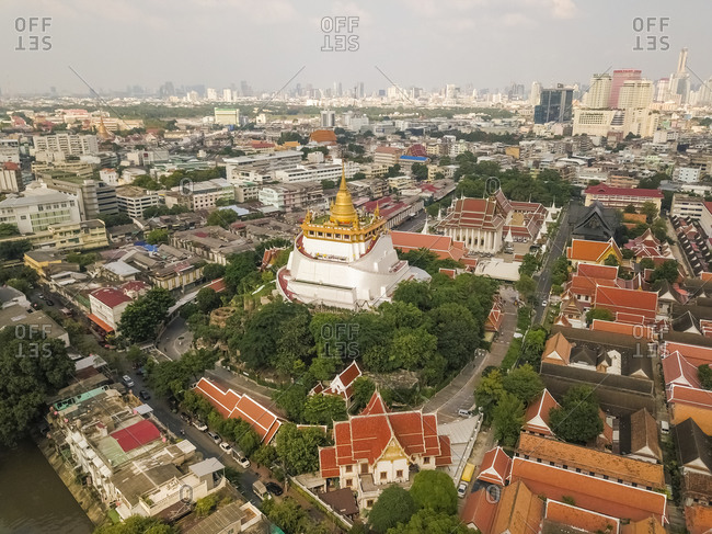 Phra Nakhon - September 25, 2019: Aerial view of the golden mountain surrounded by trees and houses, Bangkok, Thailand