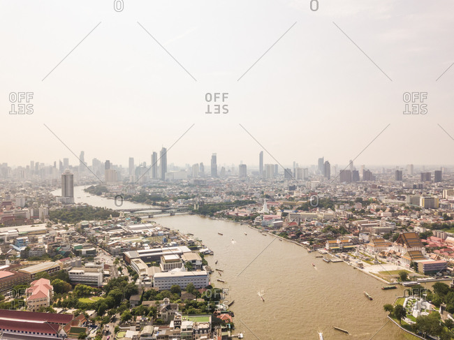 Aerial view of the Chao Phraya river with buildings in the background, Phra Nakhon, Bangkok, Thailand