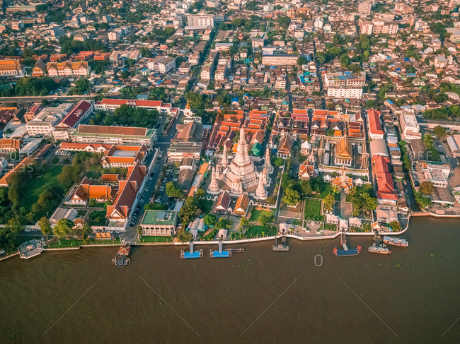 Aerial view of the Chao Phraya River with The 4 Kings' Phra Maha Chedi in the background, Phra Nakhon, Bangkok, Thailand