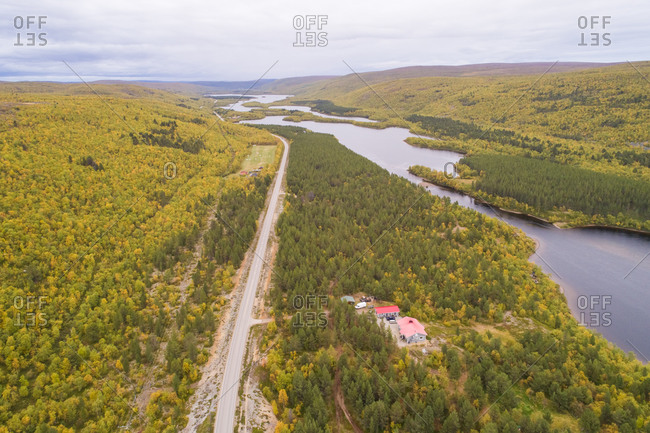 Aerial view of road crossing near lake in Varpula, Finland