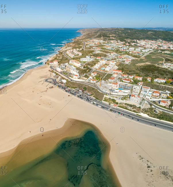 Aerial view of Praia da Foz do Arelho with houses in the background, Portugal