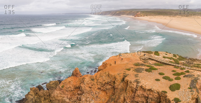 Panoramic aerial view of Praia da Bordeira, waves ideal for surfing, Carrapateira, Aljezur, Portugal