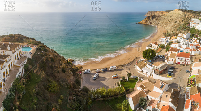 Panoramic aerial view of Praia do Burgau on a sunny day, Budens, Portugal