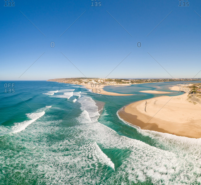 Panoramic view of waves on the shore of the beach Foz do Arelho, Portugal