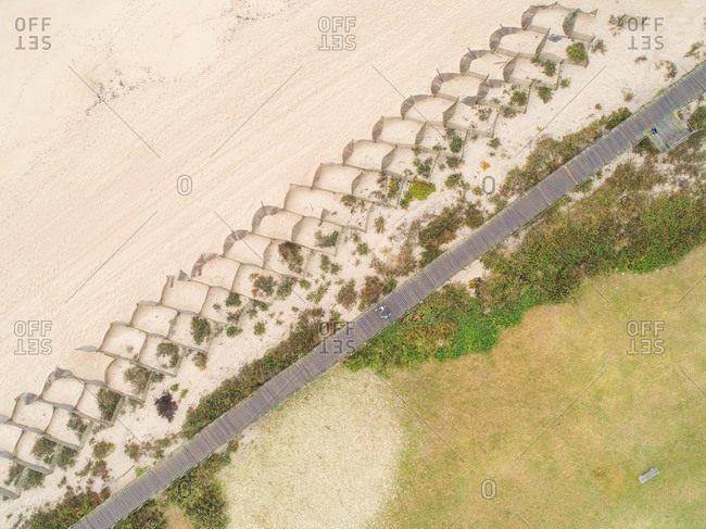 Aerial view of the beach shore with a pedestrian bridge in sao felix da Marinha, Portugal