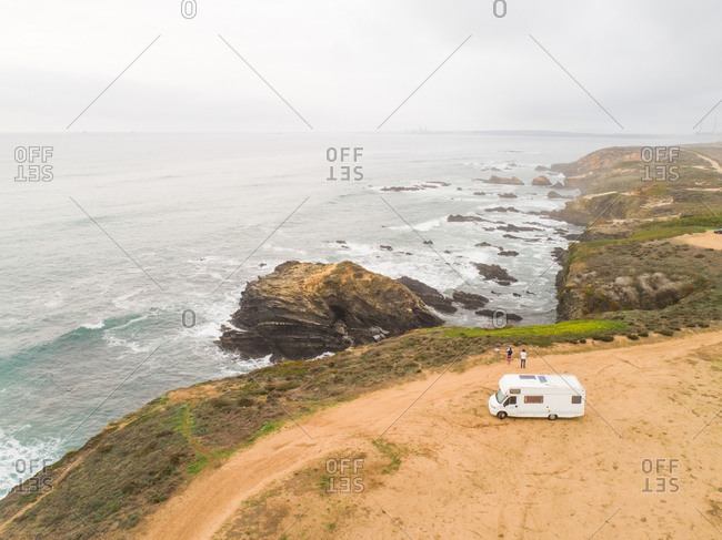 Panoramic view of the shore of the beach with a van, Praia Samoqueira, Portugal