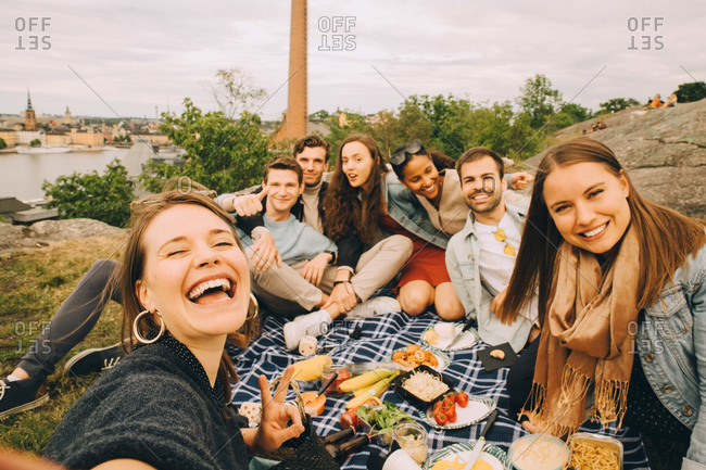Portrait of male and female friends having fun in picnic during weekend
