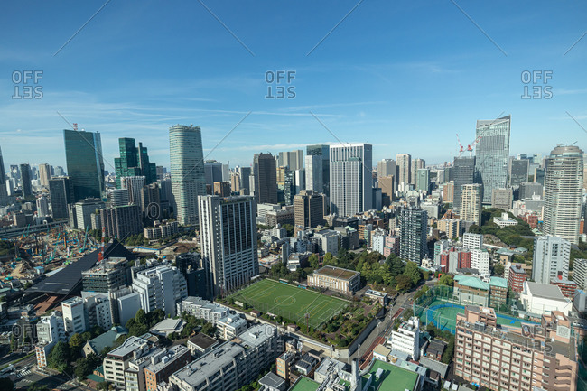 Tokyo, Japan - October 23, 2019: Aerial view over sports field surrounded by tall buildings in downtown Tokyo