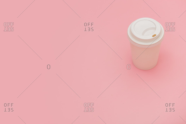 Takeaway coffee cup on pink background