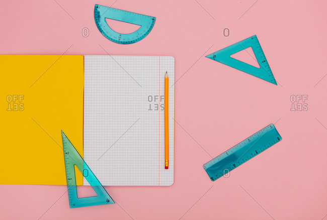 Exercise notebook, pencil and ruler with triangle