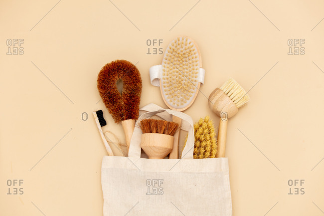 Eco-friendly wooden brushes in a bag. Above view