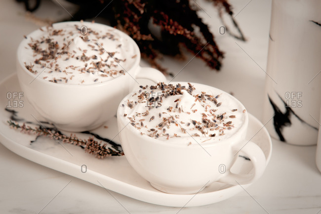 Two cups of lavender lattes