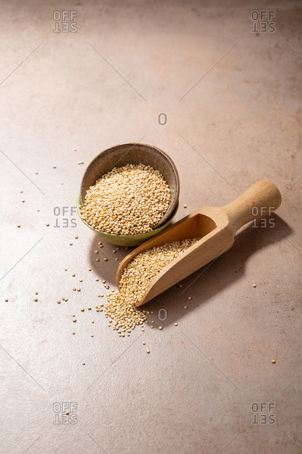 Bowl full of quinoa with wooden scoop