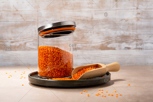 Organic red lentils in storage jar