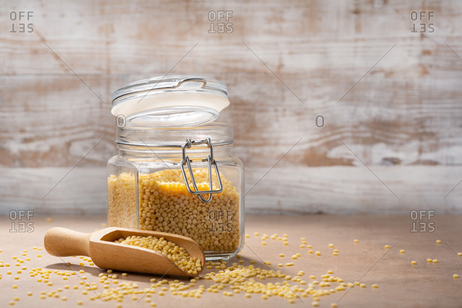 Close up of pasta ptitim on wooden background