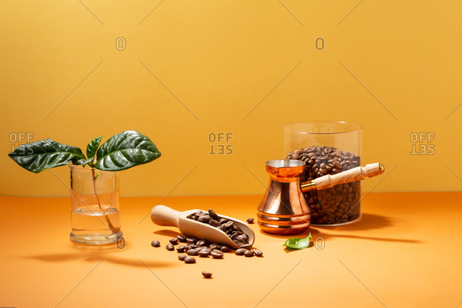 Coffee beans in jar and coffee pot