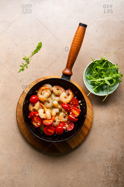 Overhead view of sauteed garlic shrimp with tomatoes