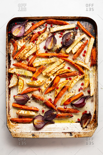 Overhead view of roasted vegetables on a baking sheet