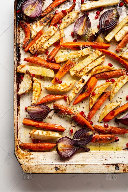 Overhead view of roasted roots on baking sheet