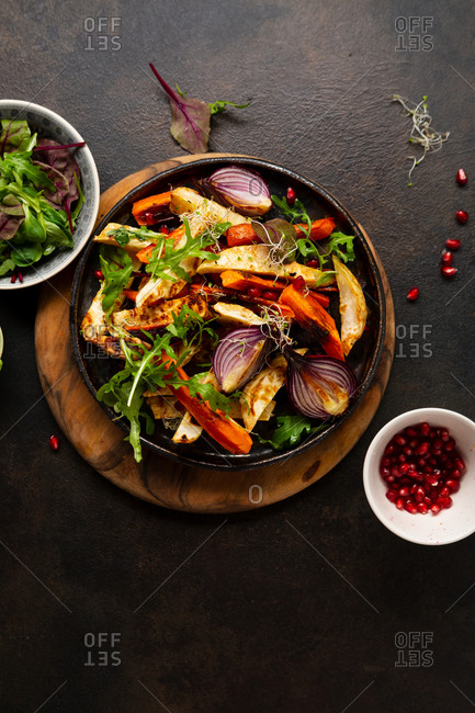 Overhead view of roasted vegetables in a round pan