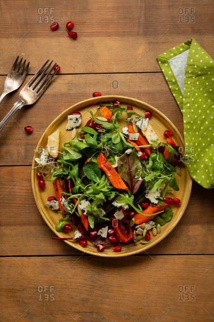 Overhead view of salad with roasted veggies