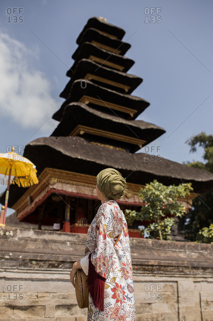 Woman standing in front of Pura Ulun Danu Beratan Temple in Bali, Indonesia