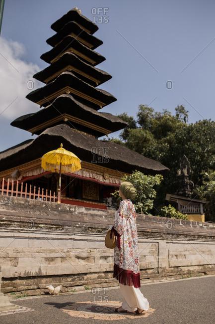 Woman in front of Pura Ulun Danu Beratan Temple in Bali, Indonesia