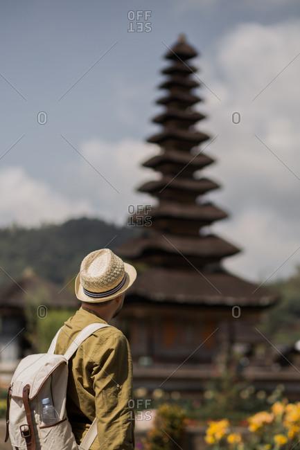 Man standing in front of Pura Ulun Danu Beratan Temple in Bali, Indonesia