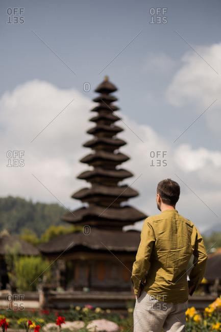 Man at the Pura Ulun Danu Beratan Temple in Bali, Indonesia